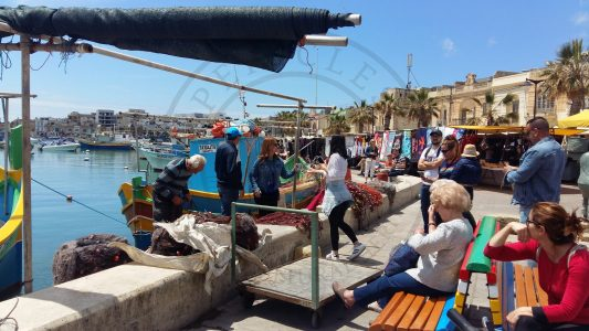 Marsaxlokk, Malta. Fishermen are an important part of the living-heritage of Marsaxlokk and they always attract the curiosity of the visitors (Photo: Jordi Vegas Macias).