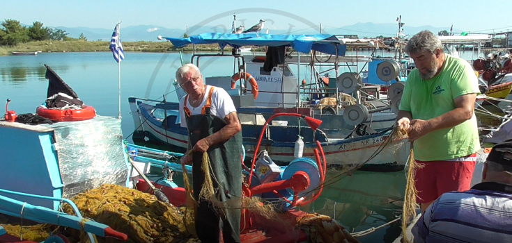 Keramoti lagoon fishing harbour, cleaning the fishing nets, Greece