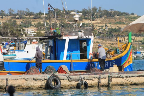 Mending fishing nets (2)