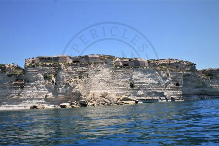 Delimara Fortress in Marsaxlokk Bay, Malta. The erosion of the coast is threatening this specific built heritage which is close to a potential collapse due to the disappearance of the cliff. While it could be a clear cause of climate change affecting maritime cultural heritage, some fishermen attribute the cause to the construction of the free port on the other side of the bay, which influenced the sea currents and the tides, causing the actual damage to the coastal landscape. The access to Delimara Fortress is closed while further discussions are still need to be done to decide the future of this historical site (Photo: Jordi Vegas Macias).