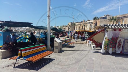 Marsaxlokk, Malta. At the waterfront of Marsaxlokk it is possible to see fishermen working, hawkers seeling souvenirs and restaurants. Even if it's a good for the tourist, the use of the space creates sometimes conflicts between the users (Photo: Jordi Vegas Macias).