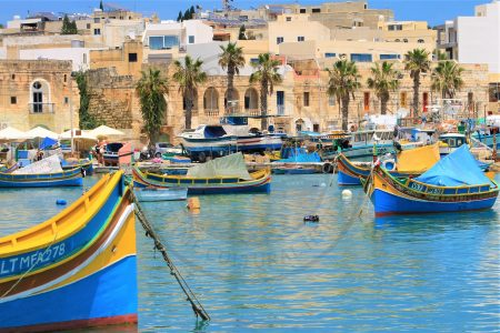 Marsaxlokk, Malta. Fishermen's houses and the traditional Luzzu vessels are still present at the waterfront of Marsaxlokk. (Photo: Jordi Vegas Macias)